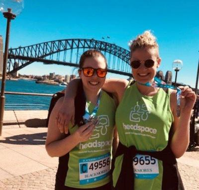 2 runners with the harbour bridge in the background